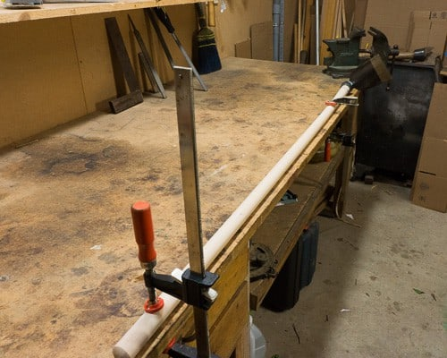 How to sharpen garden tools - hoe clamped to bench